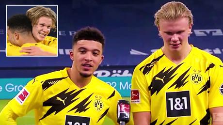 Borussia Dortmund football stars Jadon Sancho (center) and Erling Haaland © Ina Fassbender / DFL via Reuters | © Copyright Perform 2021 / Reuters