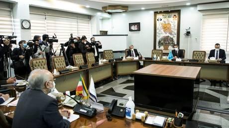 International Atomic Energy Agency (IAEA) Director General Rafael Grossi meets with head of Iran's Atomic Energy Organization Ali-Akbar Salehi, in Tehran, Iran February 21, 2021. Hadi Zand/WANA (West Asia News Agency) via REUTERS