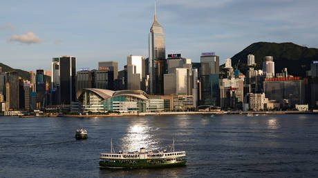 FILE PHOTO: A Star Ferry boat crosses Victoria Harbour in front of a skyline of buildings in Hong Kong, China June 29, 2020.