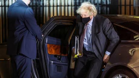 Britain's Prime Minister Boris Johnson arrives at Downing Street in London