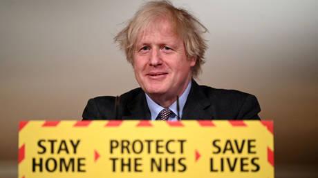 FILE PHOTO: Britain's Prime Minister Boris Johnson holds a coronavirus disease (COVID-19) pandemic media briefing at 10 Downing Street in London, Britain February 22, 2021
