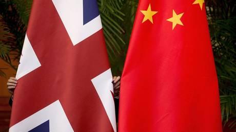 British and China national flags © REUTERS/Andy Wong