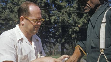 FILE PHOTO: Black man included in a syphilis study has blood drawn by a doctor in Tuskegee, Ala.