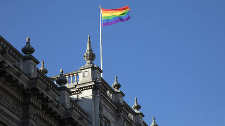 FILE PHOTO: Rainbow flag flying on the rooftop of the Cabinet Office on Whitehall on 26th February 2020 in London, United Kingdom