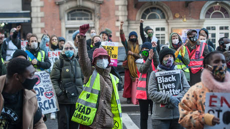 FILE PHOTO: Activists and community groups block the A10 road outside of Tottenham Police Station in protest at the targeting of black youth by officers and misuse of stop and search powers on December 19, 2020 in London, England