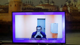 Ahead of scheduled court appearance, Russian prosecutors back prison term for opposition figure Navalny over probation violations