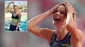 Ukrainian teen sensation Mahuchikh clears the bar at 2.06m, threatening to dethrone Maria Lasitskene in women's high jump