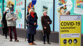 Some Covid restrictions could remain in place until ALL adults receive vaccine, UK health official says