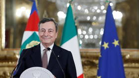 Italy's Draghi generates enough support to form new government, names physicist and banker among his ministers