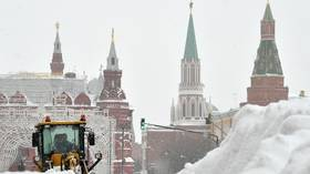 VIDEOS show mountains of snow, collapsed roofs & sliding trucks as Moscow gets hit by record-breaking snowfall