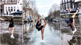 FROZEN! Dutch figure skater Linden van Bemmel wows with impromptu performance on icy Amsterdam canals