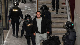 Dramatic 24-hour standoff with Spanish rapper who barricaded himself in university ends with his arrest over tweets insulting king