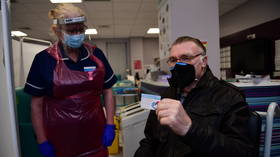 Got away with murder? Boris Johnson jokes at Covid vaccine centre as he tries to put on tight gloves 'like O.J. SIMPSON'