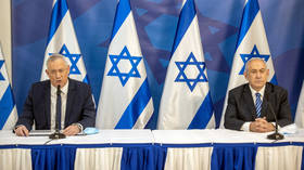 Israel suspends sending its Covid vaccine doses to other countries amid legal scrutiny & defense minister's objections