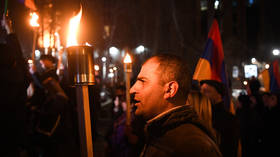 Armenian nationalists stage torch-lit march & demand 'return' of Nagorno-Karabakh amid continued political crisis in Yerevan