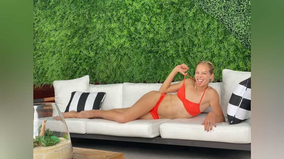 'Saying no to negative thoughts': Russian long jump siren Klishina looks on sunny side as she lounges in bright bikini