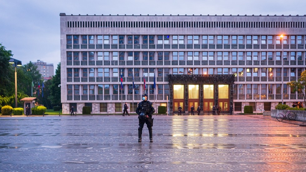 CHAINSAW-armed man who 'had enough of lockdown' wrestled to ground outside Slovenian parliament (VIDEO)
