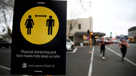 FILE PHOTO. A coronavirus warning sign is pictured in Auckland, New Zealand.