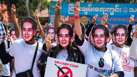 Protesters wearing masks depicting ousted leader Aung San Suu Kyi are pictured in Yangon, Myanmar on February 28, 2021.