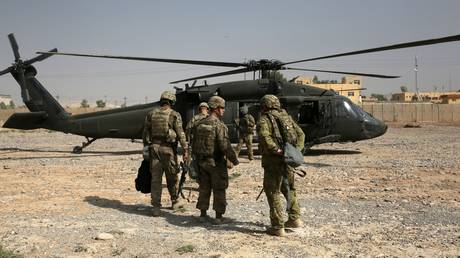 FILE PHOTO: US soldiers leave Nineveh Joint Operations Command Headquarters with helicopters to go to Al-Kayyara district and around Mosul, in Nineveh, Iraq