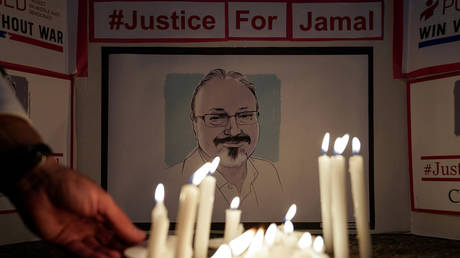 FILE PHOTO: The Committee to Protect Journalists and other press freedom activists hold a candlelight vigil in front of the Saudi Embassy to mark the anniversary of the killing of journalist Jamal Khashoggi at the kingdom's consulate in Istanbul, Wednesday evening in Washington, US, October 2, 2019