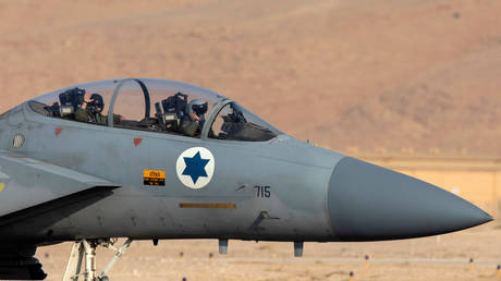 """Israeli air force pilots are seen inside the cockpit of a F15 aircraft during """"Blue Flag"""", an aerial exercise hosted by Israel"""