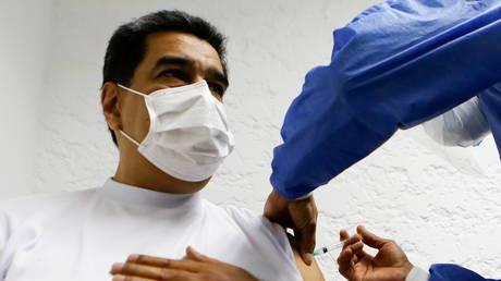 Venezuela's President Nicolas Maduro receives a dose of the Sputnik V Covid-19 vaccine in Caracas, Venezuela, March 6, 2021