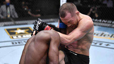 Petr Yan was disqualified after his illegal knee against Sterling. © Zuffa LLC