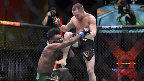 Yan planted an illegal knee on Sterling at UFC 259. © Zuffa LLC