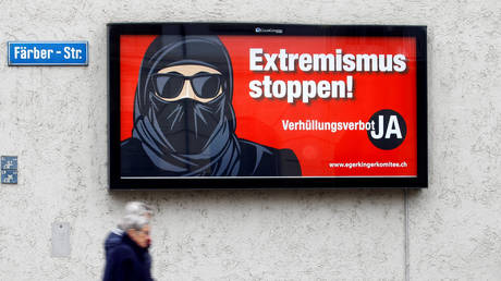 Swiss voters support 'burqa ban' that outlaws wearing of facial coverings in public places - rt