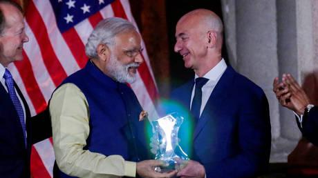 India's Prime Minister Narendra Modi presents the Global Leadership Award to Amazon CEO Jeff Bezos at the U.S.-India Business Council