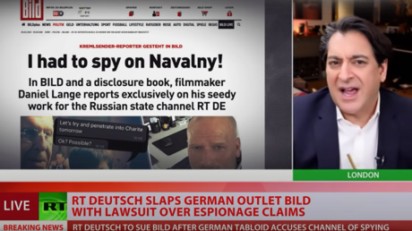 """Afshin Rattansi, host of RT's 'Going Underground,' comments on allegations of """"spying"""" against RT reporters from German tabloid Bild, March 9, 2021."""