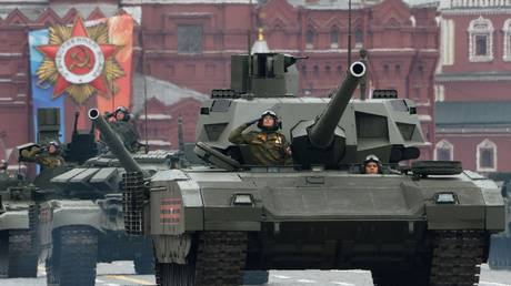 T-14 Armata tank, right, and T-72B3 tank at the final rehearsal of the military parade on Red Square, devoted to the 73rd anniversary of Victory in the Great Patriotic War.