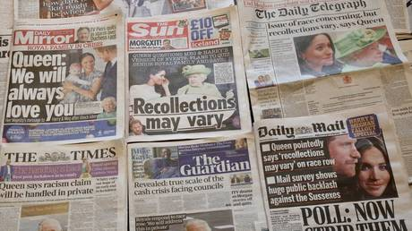 An arrangement of UK daily newspapers shows front page headlines reporting Queen Elizabeth's respond over the interview given by the Duchess of Sussex, Meghan Markle and her husband Britain's Prince Harry, Duke of Sussex, in London, United Kingdom on March 10, 2021