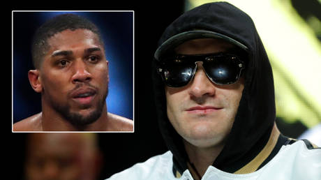 Boxing champ Tyson Fury (right) is set to fight Anthony Joshua © Andrew Couldridge / Reuters | © Steve Marcus / Reuters