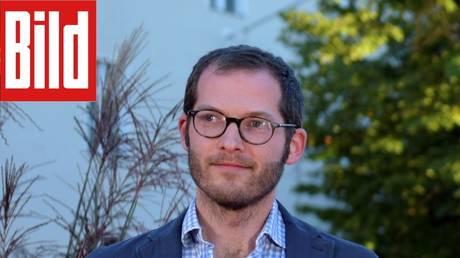 Julian Reichelt, seen alongside Bild's logo