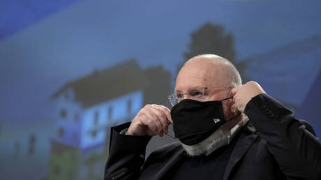 FILE PHOTO. Frans Timmermans puts on a face mask.