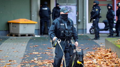 FILE PHOTO. German police officers are pictured during a raid in Berlin.
