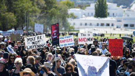 Protesters rally in response to the treatment of women in politics following several sexual assault allegations, as part of the Women's March 4 Justice rally in Canberra, Australia, March 15, 2021. © Reuters/AAP Image/Mick Tsikas