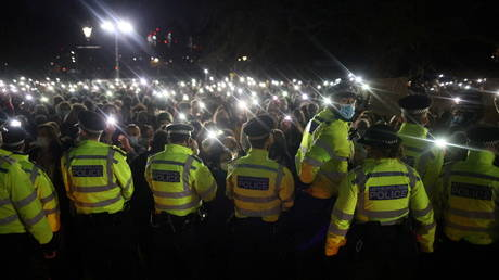 FILE PHOTO: Police members stand guard as people gather at a memorial site in Clapham Common Bandstand, following the kidnap and murder of Sarah Everard, in London, Britain March 13, 2021
