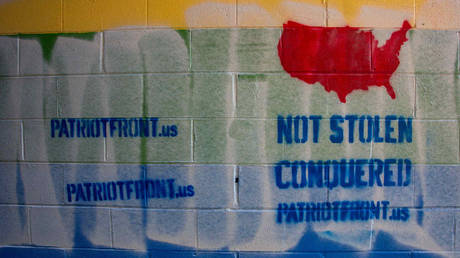 A pride mural defaced with Patriot Front graffiti pictured in Bellefonte, Pennsylvania on January 9, 2021.