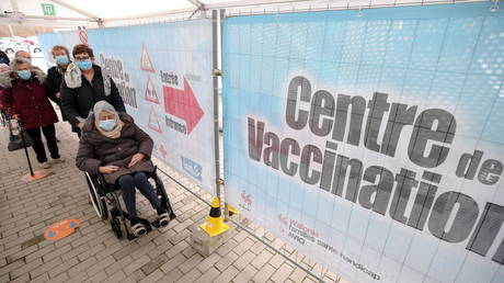 FILE PHOTO: People wait to receive Oxford/AstraZeneca's COVID-19 vaccine at a vaccination centre in Bierset, Belgium March 17, 2021