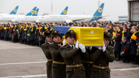 Soldiers carry coffin remains of one of victims of Ukraine International Airlines flight 752 plane disaster, Kiev, Ukraine, January 19, 2020