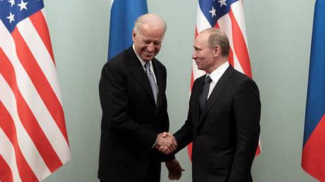 Vladimir Putin shakes hands with Joe Biden during their meeting in Moscow (2011)