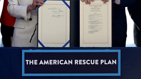 "House Speaker Nancy Pelosi (D-CA) and Senate Majority Leader Chuck Schumer display the ""American Rescue Plan"""