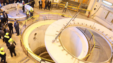 Members of the media and officials tour the water nuclear reactor at Arak, Iran December 23, 2019.
