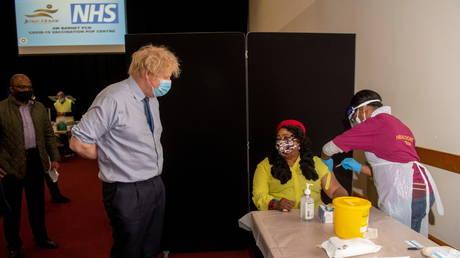 Britain's Prime Minister Boris Johnson visits a COVID-19 vaccination centre, amid the coronavirus disease (COVID-19) pandemic, in London, Britain, March 7, 2021.