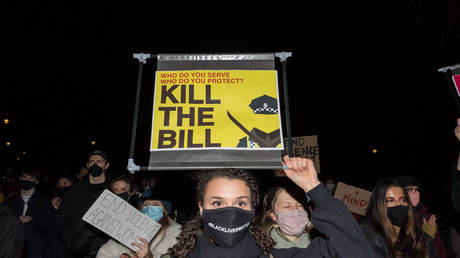 Protesters demonstrate in Parliament Square against the passage of a new policing bill in the House of Commons on 16 March, 2021 in London, England.