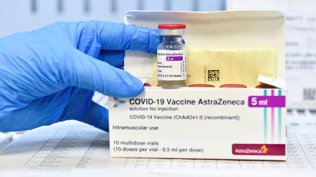 FILE PHOTO: A healthcare worker shows a vial and a box of the AstraZeneca coronavirus disease (COVID-19) vaccine, as vaccinations resume after a brief pause in their use over concern for possible connection to blood clots, in Turin, Italy, March 19, 2021.