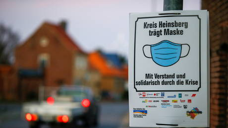 A placard reading 'Heinsberg county wears face mask' is pictured in the small town Gangelt, one of Germany's first coronavirus pandemic hotspots, amid the coronavirus disease (COVID-19) pandemic in Gangelt, Germany, February 23, 2021. Picture taken February 23, 2021.